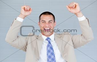 Successful businessman puniching the air