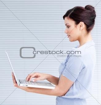 Confident businesswoman using a laptop