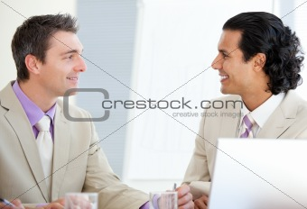 Assertive businessmen interacting