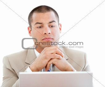 Handsome businessman using his laptop in the office