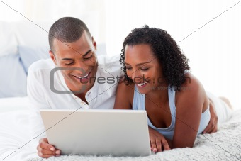 Affectionate couple using a laptop