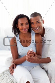 Smiling Afro-american couple finding out results of a pregnancy