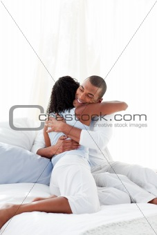 Romantic couple hugging on their bed