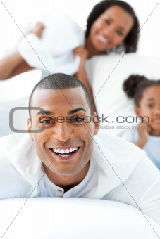 Attractive man having fun with his wife and his daughter