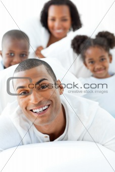 Attractive man having fun with his family