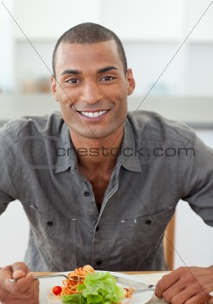 Portrait of ethnic man dinning