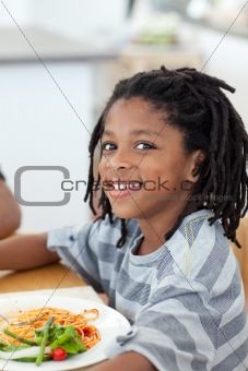 Portrait of ethnic little boy dining