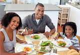 Ethnic couple dining with their son