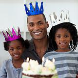 Smiling father with his children celebrating a birthday