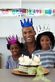 Joyful Afro-american father with his children celebrating a birt