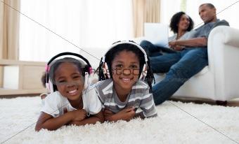 Cute siblings listening music
