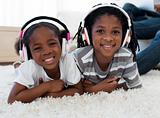 Adorable siblings listening music