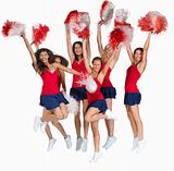Team of cheerleaders jumping of joy on white