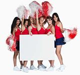 Young cheerleaders holding a blank billboard for you text
