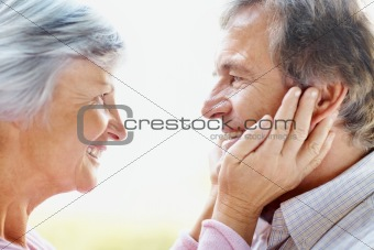 Profile of a senior couple spending romantic time together