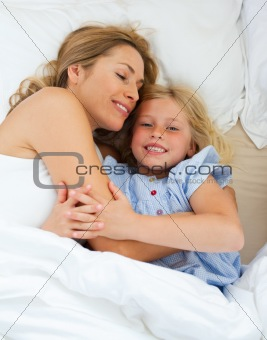 Adorable child hugging with her mother