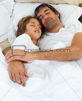 Affectionate father and his son sleeping together