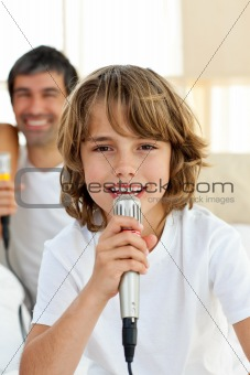 Little boy singing with a microphone