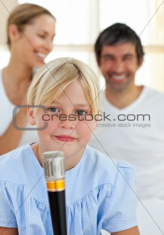 Blond child singing with a microphone