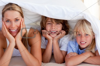 Attractive mother having fun with her children