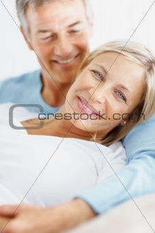 Affectionate mature man embracing a cute middle aged woman