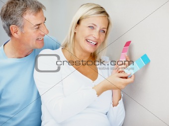 Blue or pink? Pregnant couple deciding a color for the wall
