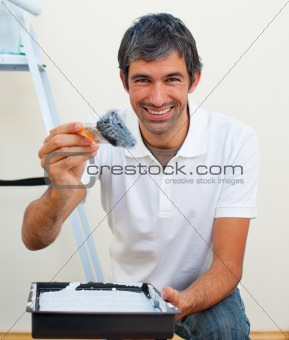 Attractive man painting a wall