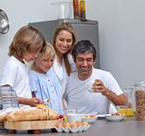 Joyful family having breakfast