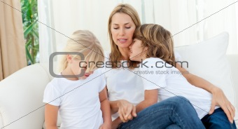 Blond mother having fun with her children