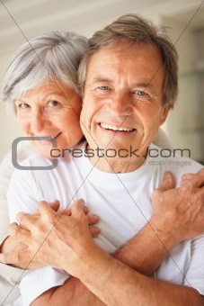 Affectionate elderly couple hugging each other