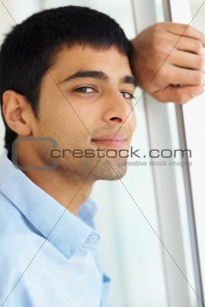 Closeup of a Caucasian young guy thinking about the future