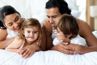 Parents and children lying on the bed