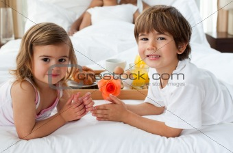 Close-up of cute brother and sister having breakfast with their