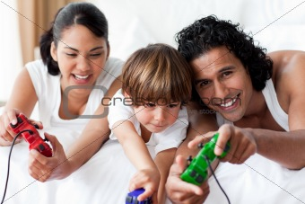 Portrait of smiling parents playing video games with their son