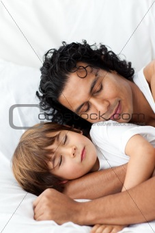 Little boy and his father sleeping together