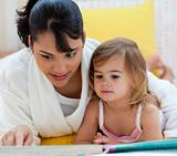 Mother and daughter doing homework together at home