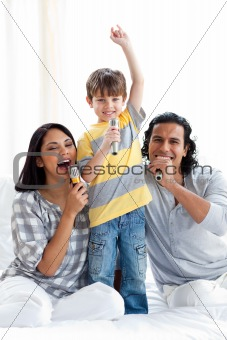 Caring parents playing with their children on sofa at home