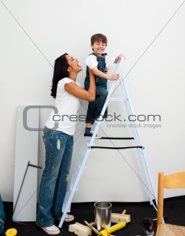 Adorable little boy climbing a ladder
