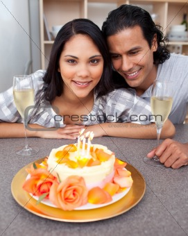 Attractive woman celebrating her birthday with her husband