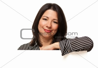 Attractive Multiethnic Woman Resting Arm Behind Blank Sign Corner Isolated on a White Background.