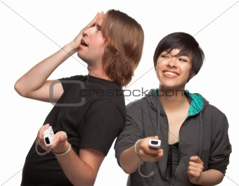 Diverse Couple with Video Game Controllers Having Fun Isolated on a White Background.
