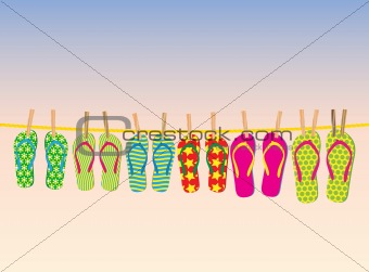 Flip-flops on a rope with the evening sky behind