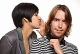 Attractive Diverse Couple Whispering Secrets Isolated on a White Background.