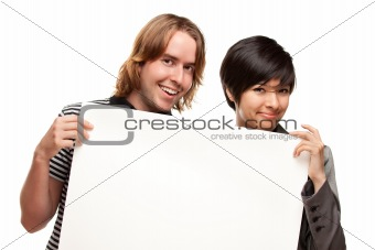 Attractive Diverse Couple Holding Blank White Sign Isolated on a White Background.