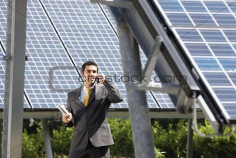 businessman and solar panels