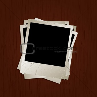 Blank photos on wooden background