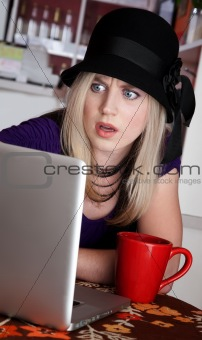 Astonished lady with red mug