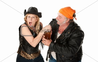 Motorcyle gang couple arguing about a beer bottle