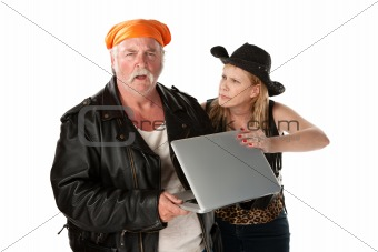 Mature biker couple arguing about a computer