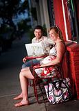 Happy couple sitting outside
